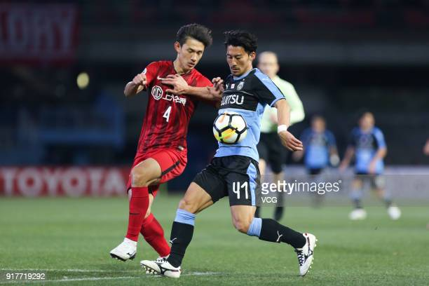 Wang Shenchao of Shanghai SIPG and Akihiro Ienaga of Kawasaki Frontale vie for the ball during the 2018 AFC Champions League Group F match between...