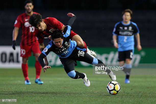 Wang Shenchao of Shanghai SIPG and Tatsuya Hasegawa of Kawasaki Frontale fight for the ball during the AFC Champions League Group F match between...