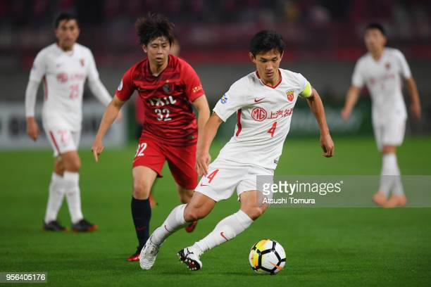 Wang Shenchao of Shanghai SIPG controls the ball under pressure of Koki Anzai of Kashima Antlers during the AFC Champions League Round of 16 first...
