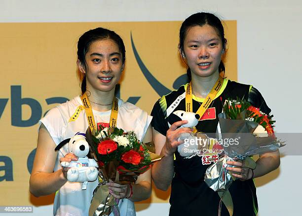 Wang Shixian of China and Li Xuerui of China pose for photographs after the Final of the Women's Singles of the Malaysia Badminton Open on January 19...