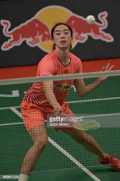 Wang Shixian of China hits a return as she plays against Iris Wang of the US during their women's singles qualifying match at the 2015 World...