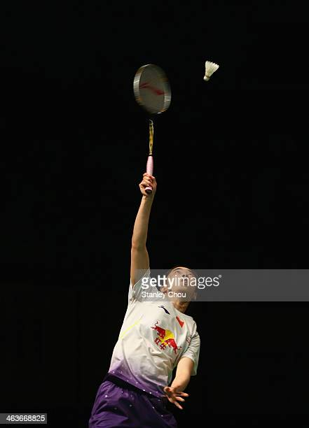 Wang Shixian of China plays a shot to Li Xuerui of China during the Final of the Malaysia Badminton Open on January 19 2014 in Kuala Lumpur Malaysia