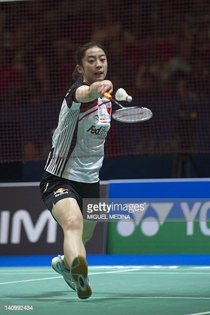 Wang Shixiang of China returns the shuttlecock against Jiang Yanjiao of China during the women's singles quarter-finals match at the All England Open...