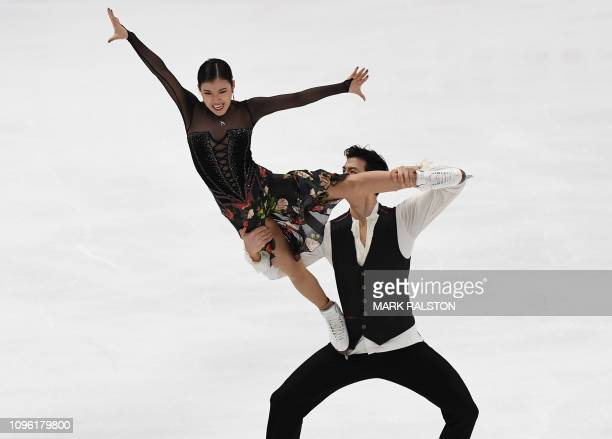 Wang Shiyue and her partner Liu Xinyu of China compete in the Ice Dance Rhythm Dance competition during the ISU Four Continents Figure Skating...