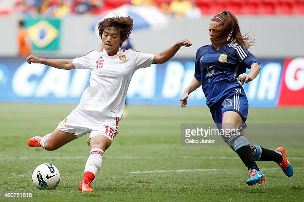 Wang Shuang of China and Camila Gomez Ares of Argentina compete in the Brasilia International Tournament match between Argentina and China at Mane...