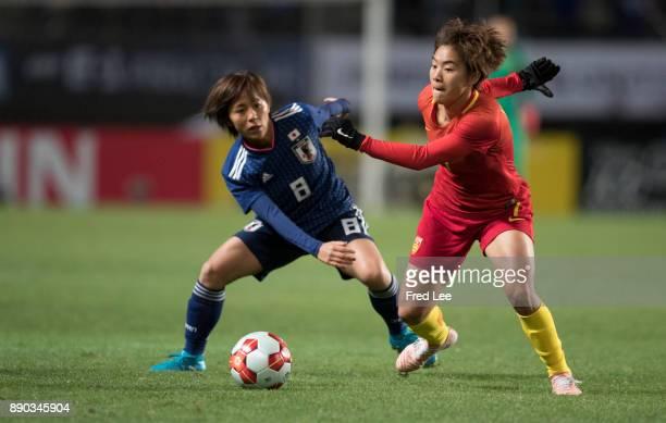 Wang shuang of China and Iwabuchi Mana of Japan vie for the ball the EAFF E1 Women's Football Championship between Japan and China at Fukuda Denshi...