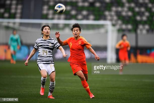 Wang Shuang of China and Kang Chae-rim of South Korea fight for the ball during the Tokyo Olympics Women's Football Asian Final Qualifier 2nd leg...