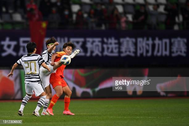 Wang Shuang of China and Lim Seon-joo of South Korea fight for the ball during the Tokyo Olympics Women's Football Asian Final Qualifier 2nd leg...