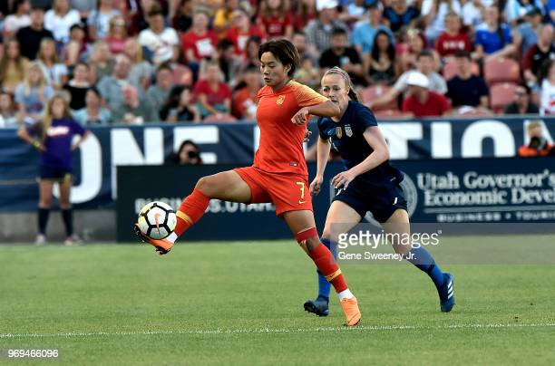 Wang Shuang of China directs the ball away from Becky Sauerbrunn of the United States in the first half of an international friendly soccer match at...