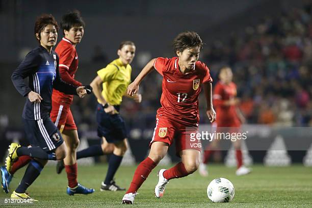 Wang Shuang of China drives the ball during the AFC Women's Olympic Final Qualification Round match between Japan and China at Kincho Stadium on...