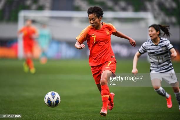 Wang Shuang of China drives the ball during the Tokyo Olympics Women's Football Asian Final Qualifier 2nd leg match between China and South Korea at...