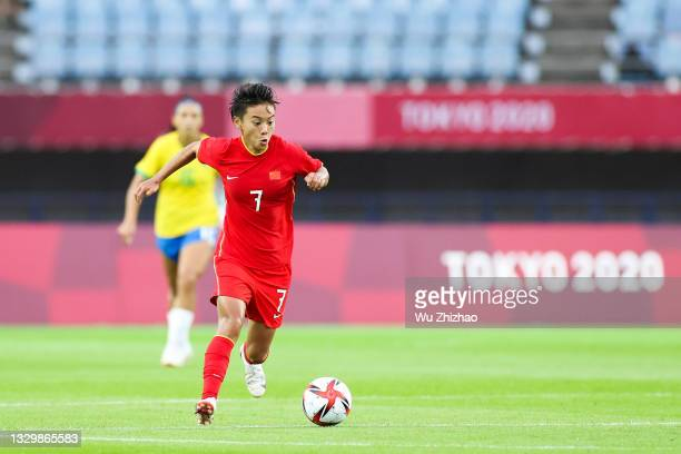 Wang Shuang of China drives the ball in the Women's First Round Group F match between China and Brazil during the Tokyo 2020 Olympic Games at Miyagi...