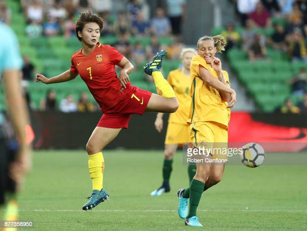 Wang Shuang of ChinaPR challenges Emily van Egmond of the Matildas during the Women's International match between the Australian Matildas and China...