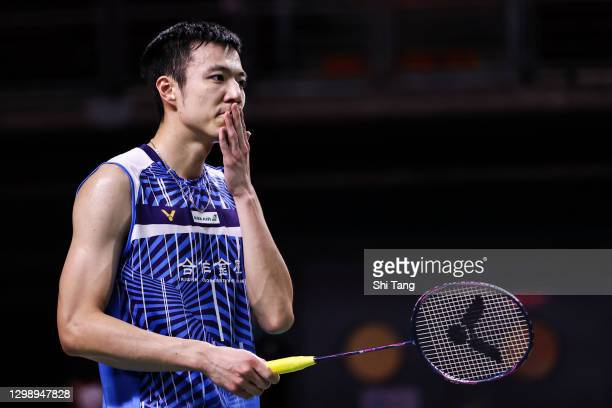 Wang Tzu Wei of Chinese Taipei reacts in the Men's Singles round robin match against Ng Ka Long Angus of Hong Kong on day one of the HSBC BWF World...