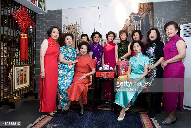 Wang Weiyu seated in blue poses with her students all wearing Qipao traditional dresses in her Qipao salon on April 19 2010 in Shanghai China...