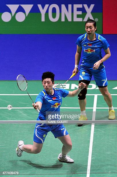 Wang Xiaoli and Yu Yang of China return against Ma Jin and Tang Yuanting of China in their All England Open Badminton Championships women's doubles...