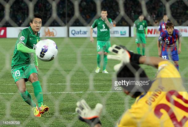 Wang Xiaolong of Beijing Guoan scores his team's first goal with a penalty during the AFC Champions League group F match between Beijing Guoan and FC...