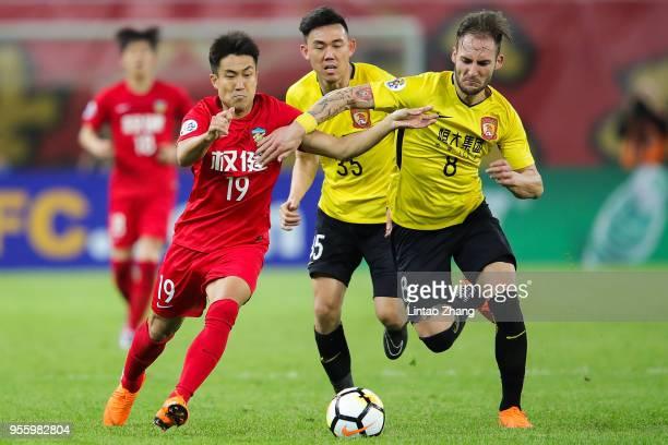 Wang Xiaolong of Tianjin Quanjian competes the ball with Nemanja Gudelj of Guangzhou Evergrande during the AFC Champions League Round of 16 first leg...
