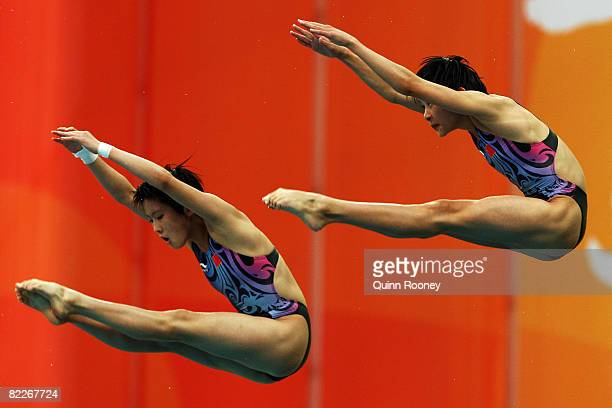 Wang Xin and Chen Ruolin of China perform during the Women's Synchronised 10m Platform held at the National Aquatics Center during day 4 of the...