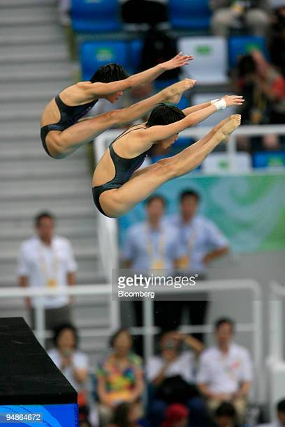 Wang Xin left and Chen Ruolin of China hold a pike position women's 10meter synchronized diving event during day four of the 2008 Beijing Olympics in...