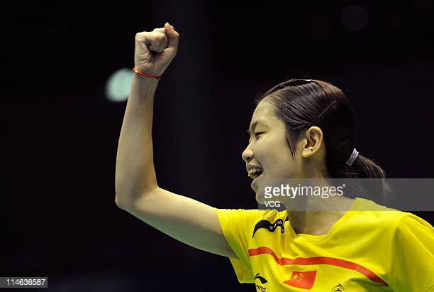 Wang Xin of China celebrates during her match against Sayaka Sato of Japan during day three of the 12th Sudirman Cup at Qingdao Sports Center on May...