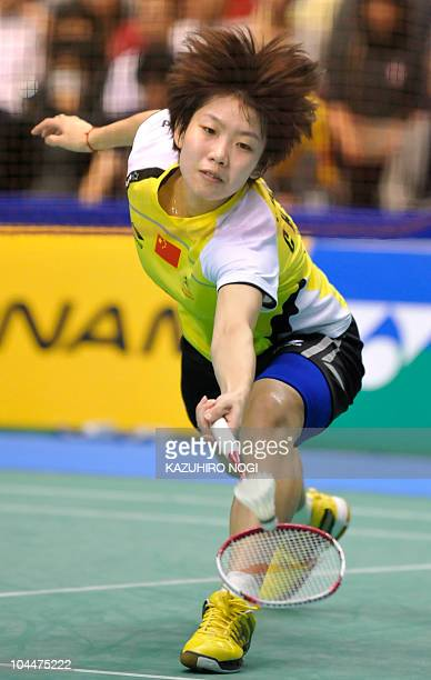 Wang Xin of China returns a shot against her compatriot Jiang Yanjiao during the women's singles final match at the Japan Open badminton tournament...