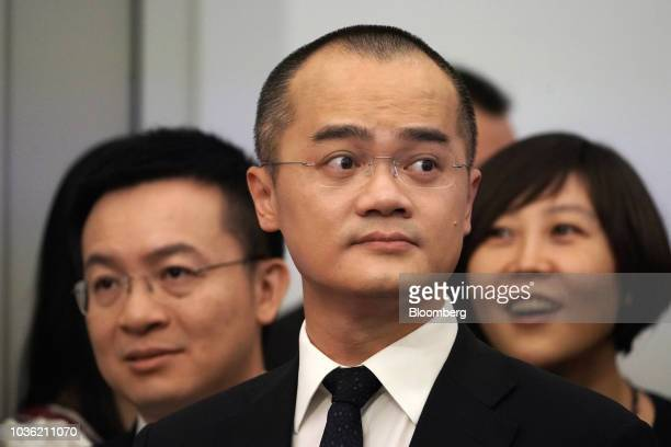 Wang Xing chairman chief executive officer and cofounder of Meituan Dianping center attends the company's listing ceremony at the Hong Kong Stock...
