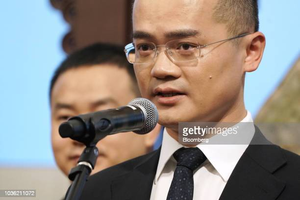 Wang Xing chairman chief executive officer and cofounder of Meituan Dianping speaks during the company's listing ceremony at the Hong Kong Stock...