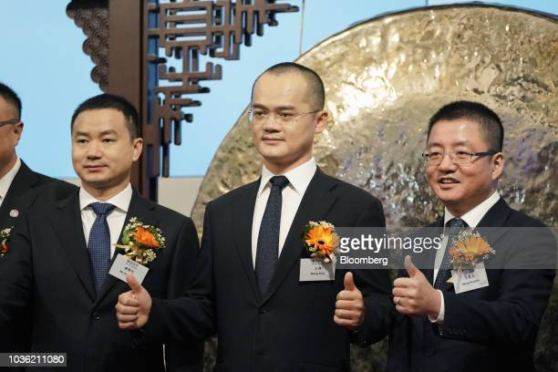 Wang Xing chairman chief executive officer and cofounder of Meituan Dianping center Mu Rongjun senior vice president and cofounder left and Wang...
