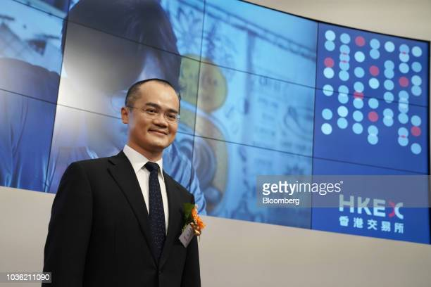 Wang Xing chairman chief executive officer and cofounder of Meituan Dianping stands for photographs during the company's listing ceremony at the Hong...