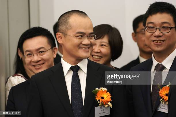 Wang Xing chairman chief executive officer and cofounder of Meituan Dianping center and Zhang Chuan senior vice president right attend the company's...