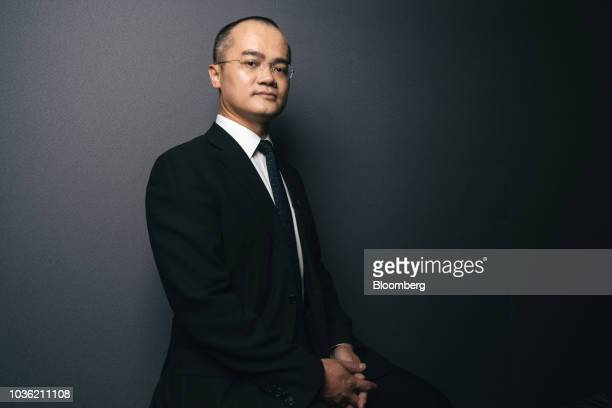 Wang Xing chairman chief executive officer and cofounder of Meituan Dianping poses for a photograph ahead of a Bloomberg Television interview...