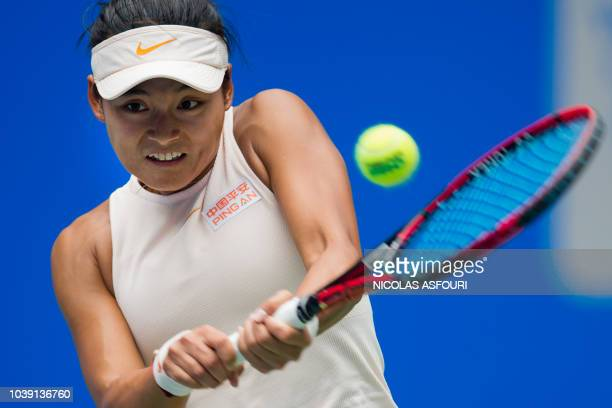 TOPSHOT Wang Yafan of China hits a return against Madison Keys of the US during their women's singles second round match of the WTA Wuhan Open tennis...