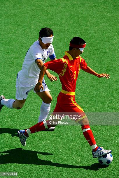 Wang Yafeng of China competes in the FiveASide Football match between China and South Korea at Olympic Green Hockey Field B during day five of the...