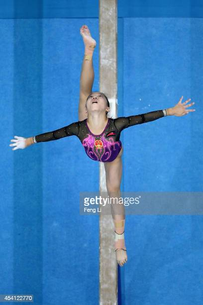 Wang Yan of China competes in the Women's Balance Beam Final on day eight of the Nanjing 2014 Summer Youth Olympic Games at Nanjing OSC Gymnasium on...