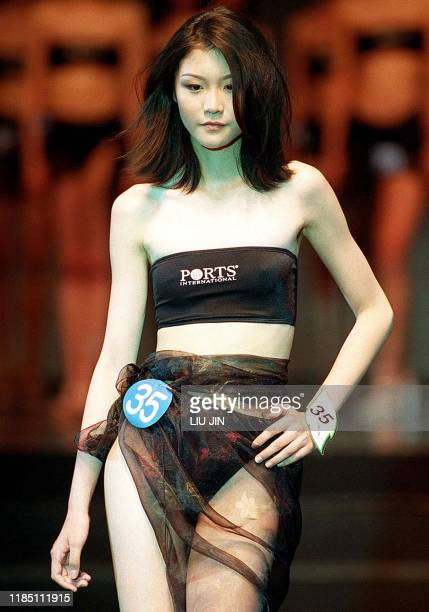 Wang Yang a 16yearold high school student from Zhejiang province stages the podium at the Shanghai Ascend International Model Competition after she...