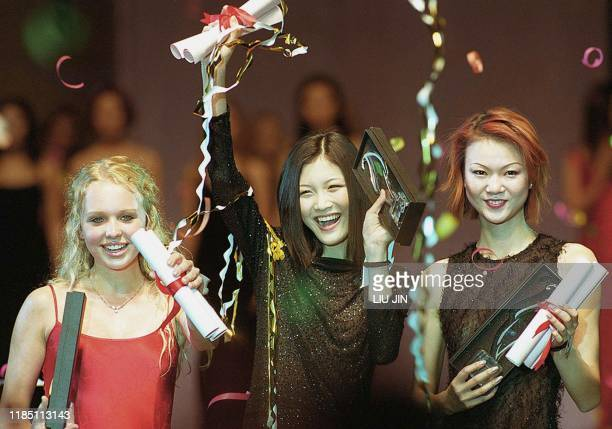 Wang Yang a 16yearold high school student from Zhejiang province holds up her golden award at the Shanghai Ascend International Model Competition 14...