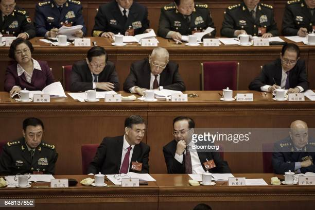 Wang Yang China's vice premier front center left speaks with Sun Zhengcai Chinese Communist Party secretary of Chongqing front center right during...