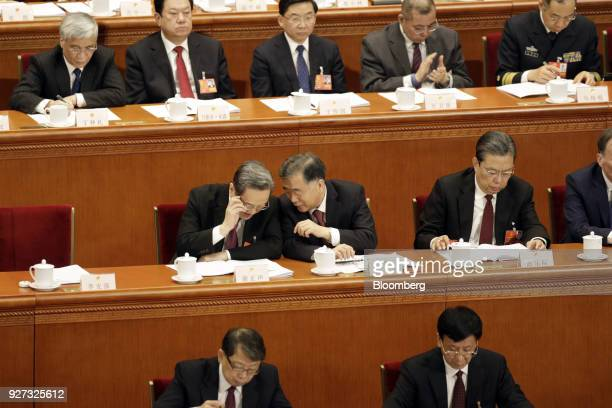 Wang Yang China's vice premier second row center speaks with Yu Zhengsheng chairman of the Chinese People's Political Consultative Conference second...