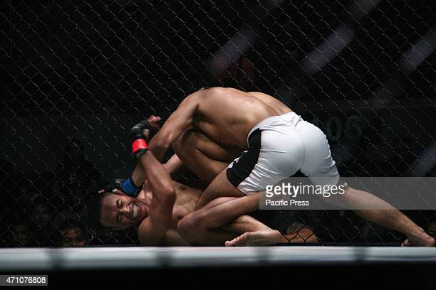 Wang Ye Wei tries to pin down Sunoto at the Mall of Asia Arena in Pasay City during the One Championship Valor of Champions fight night The main...