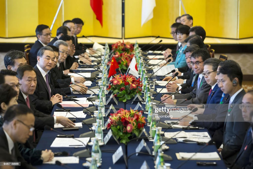 Wang Yi, China's foreign minister, center left, and Taro Kono, Japan's foreign minister, fifth right, attend a high-level Japan-China economic dialogue in Tokyo, Japan, on Monday, April 16, 2018. The foreign ministers of China and Japan agreed to work closely to push North Korea to abandon its nuclear program, in the latest sign of improved cooperation between Asia's two largest economies. Photographer: Tomohiro Ohsumi/Bloomberg via Getty Images