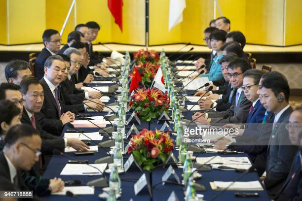 Wang Yi China's foreign minister center left and Taro Kono Japan's foreign minister fifth right attend a highlevel JapanChina economic dialogue in...