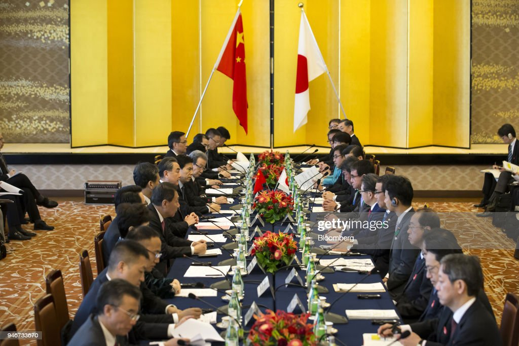Wang Yi, China's foreign minister, seated eighth left, and Taro Kono, Japan's foreign minister, seated eigthth right, attend a high-level Japan-China economic dialogue in Tokyo, Japan, on Monday, April 16, 2018. The foreign ministers of China and Japan agreed to work closely to push North Korea to abandon its nuclear program, in the latest sign of improved cooperation between Asia's two largest economies. Photographer: Tomohiro Ohsumi/Bloomberg via Getty Images