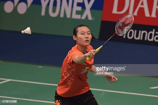 Wang Yihan of China returns a shuttle cock to Karin Schnaase of Germany during a qualification of the Indonesia Open in Jakarta on June 4 2015 Wang...