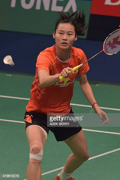 Wang Yihan of China returns a shuttle cock to Karin Schnaase of Germany during a qualification in the 2015 Indonesia Open in Jakarta on June 4 2015...