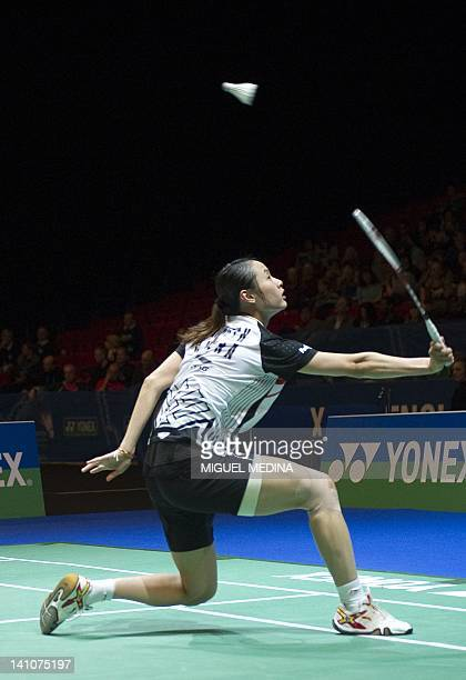Wang Yihan of China returns the shuttlecock against Wang Shixian of China during the women's singles semifinals match at the All England Open...