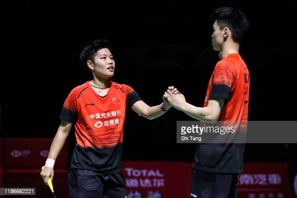 Wang Yilyu and Huang Dongping of China celebrate the victory in the Mixed Double final match against Zheng Siwei and Huang Yaqiong of China on day...