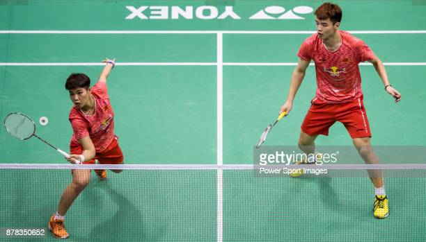 Wang Yilyu and Huang Dongping of China in action against 'nYugo Kobayashi and Misaki Matsutomo of Japan during their mixed doubles qualification...