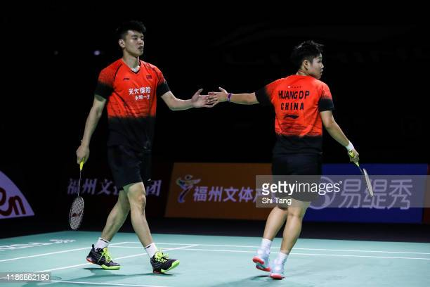 Wang Yilyu and Huang Dongping of China react in the Mixed Double final match against Zheng Siwei and Huang Yaqiong of China on day six of the Fuzhou...