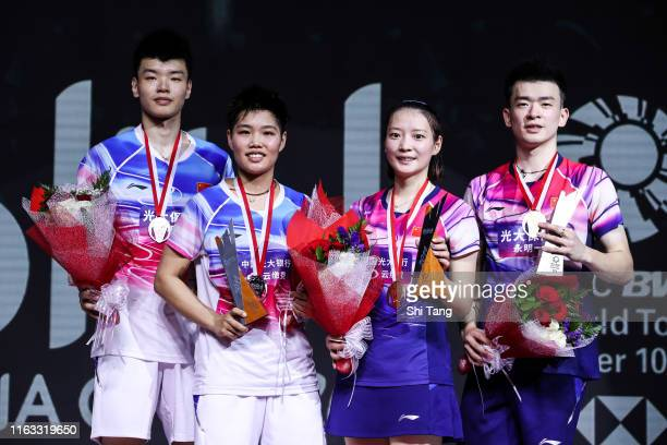 Wang Yilyu Huang Dongping Zheng Siwei and Huang Yaqiong of China pose with their trophies after the Mixed Double final match on day six of the BliBli...